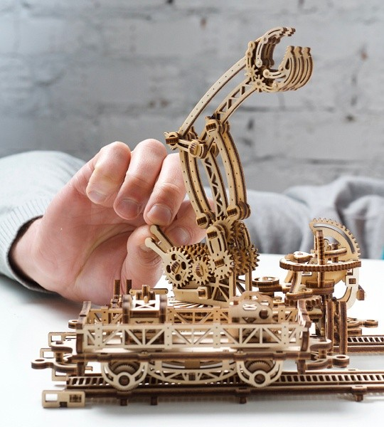 Ugears mechanical model kit Rail Mounted Manipulator and wooden 3D puzzle. Articulated claw on rotating platform with control levers, tracks, crane and characters. Original gift for boys and girls and smart hobby for grown-ups.