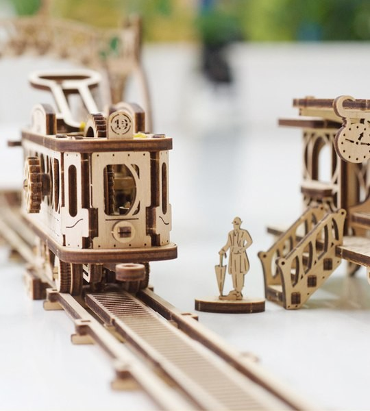 Ugears mechanical model kit Tram Line and wooden 3D puzzle. Street tramcar, ticket stop, depot, footbridge and characters. Original gift for boys and girls and smart hobby for grown-ups.